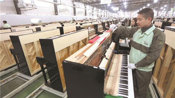"""世界的人口ppt_长江钢琴:走向世界的""""宜昌品牌"""""""